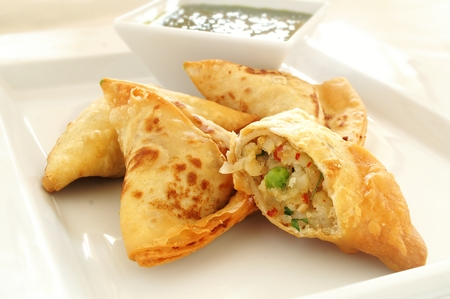 indian traditional: Traditional Indian samosas with coriander dip Stock Photo