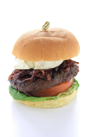 beefburger: gourmet beefburger with goats cheese isolated
