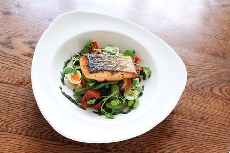 seared: pan seared salmon steak with bean salad meal Stock Photo