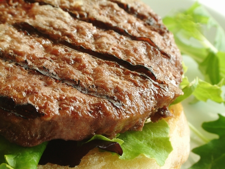 burger: burgers cooking on barbecue