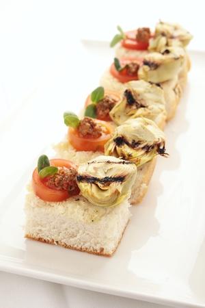 canapes: artichoke tomato pesto canapes Stock Photo