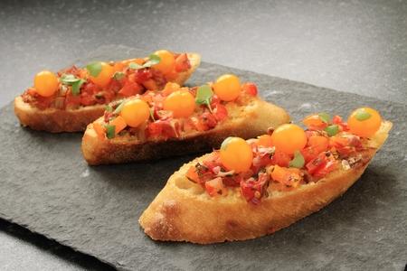 bruschetta: bruschetta with orange tomatoes Stock Photo