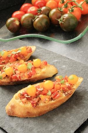 entrees: bruschetta with orange tomatoes Stock Photo