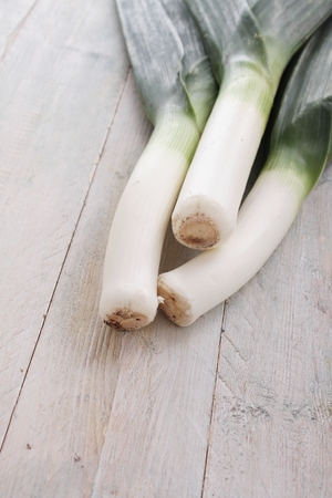 leeks: fresh leeks on wooden table