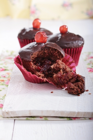 filled: chocolate cherry filled cup cakes Stock Photo