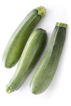 courgettes: fresh whole courgettes Stock Photo
