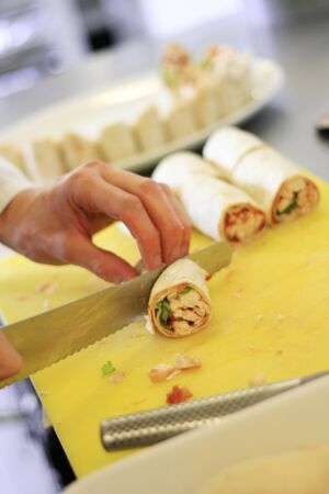 slicing: chef slicing wrap Stock Photo