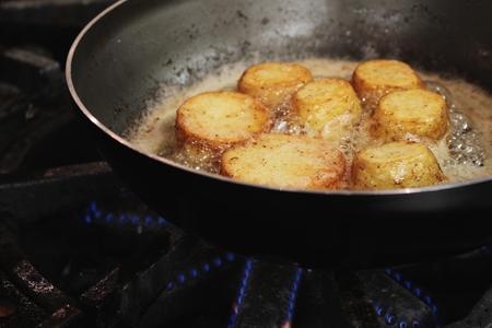 frying: potatoes frying in pan