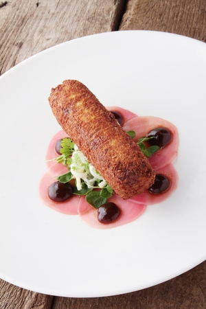 and savory: savory croquette plated appetizer