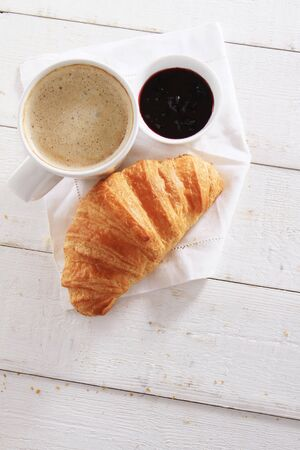 fresh baked: fresh baked croissant with coffee