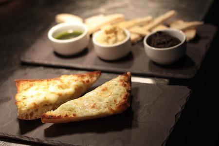 entrees: garlic bread and hummus dip appetizer