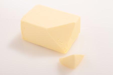 pat: butter pat in foil wrap Stock Photo