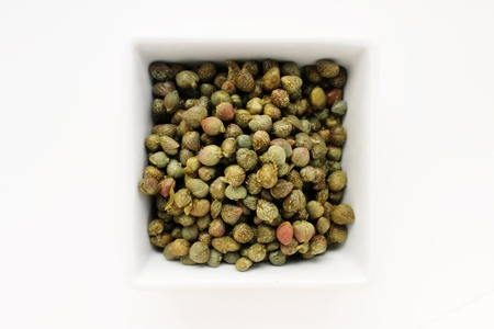 caper: caper berries isolated on white Stock Photo