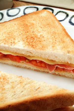 toasted sandwich: cheese and ham toasted sandwich Stock Photo