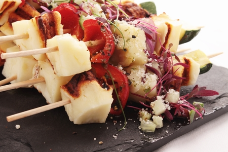 grilled halloumi vegetable kebabs Stock Photo