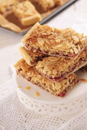 slice of cake: almond slice cake dessert Stock Photo