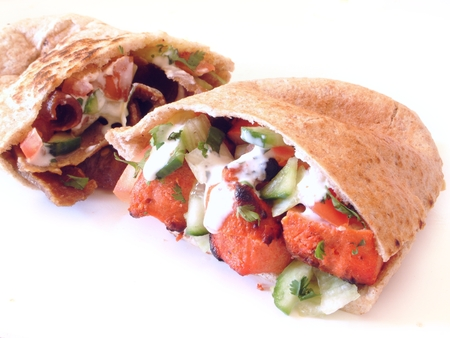 preperation: tikka chicken flat bread pitta Stock Photo