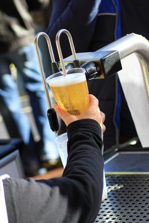beer pump: serving beer pump tap Stock Photo