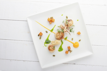 pan fried scallops plated meal appetizer starter Stock Photo