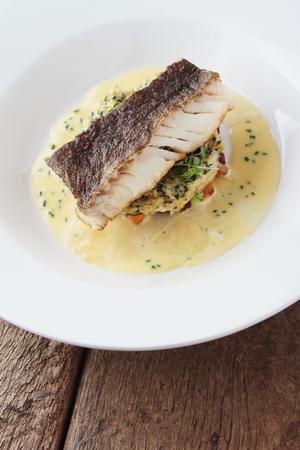 fish dinner: plated cod fish dinner Stock Photo