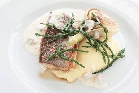 fish dinner: plated fish dinner Stock Photo