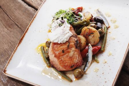 salmon fillet: salmon fillet plated meal
