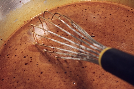 whisking: cooking in kitchen Stock Photo