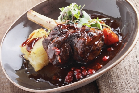 roast lamb shank plated meal
