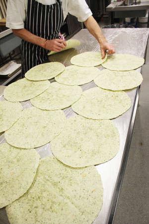 preperation: chef preparing indian chick pea wrap Stock Photo