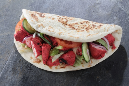 shish: indian tikka shish donner wrap sandwich Stock Photo