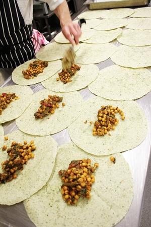 chick pea: chef preparing indian chick pea wrap Stock Photo