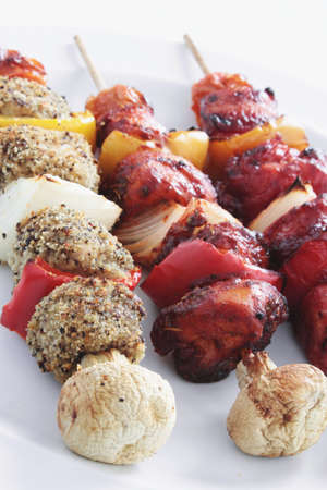 charcuter�a: chicken pork meat kebabs on barbeque