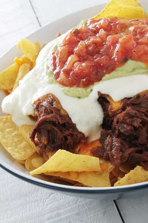pulled: tortilla chips with pulled pork Stock Photo