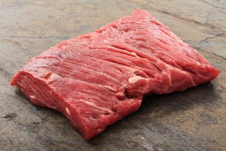 uncooked: raw uncooked brisket flat iron steak