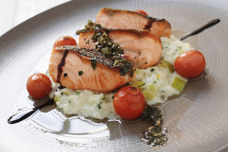 salmon fillet: plated salmon fillet risotto meal Stock Photo