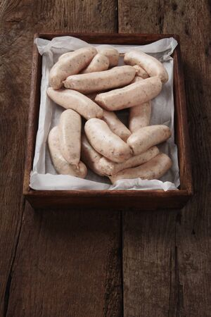 linked: uncooked linked British sausages