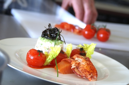 plating: chef cooking and preparing plated meal