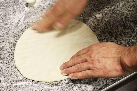 preparing: chef preparing pizza Stock Photo