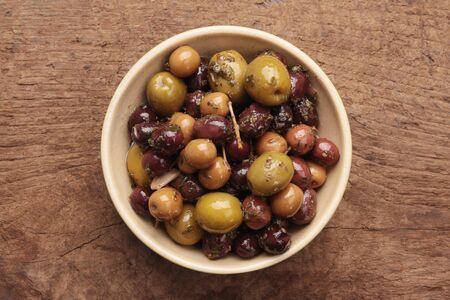 antipasto: mixed olives antipasto in dish Stock Photo