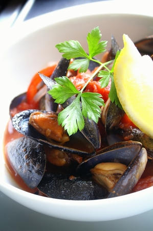 bivalve: fresh cooked mussels plated meal