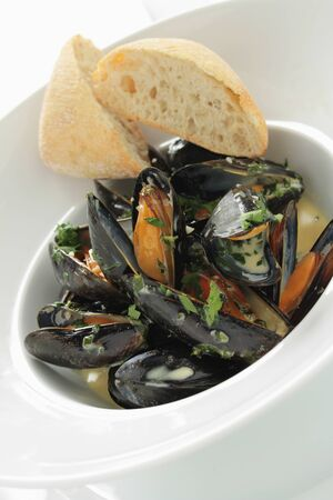 mussels: cooked mussels moules marinier Stock Photo