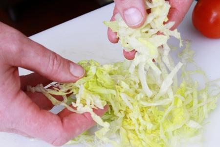 strips away: chef preparing chicken wrap