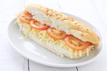 sub: cheese and tomato sub sandwich Stock Photo