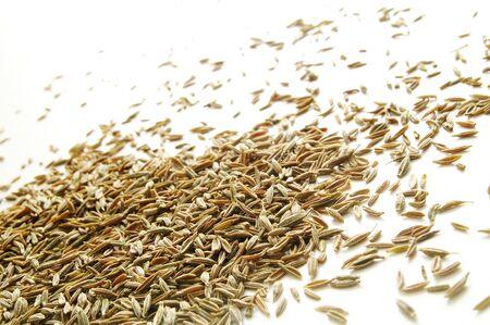 cumin: pile of cumin seeds isolated on white Stock Photo