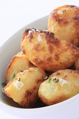 roast potatoes: roast potatoes in serving dish Stock Photo