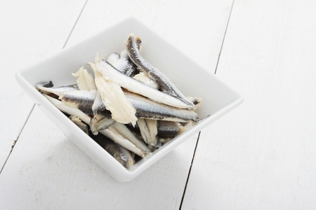 pickled: pickled anchovies in white dish