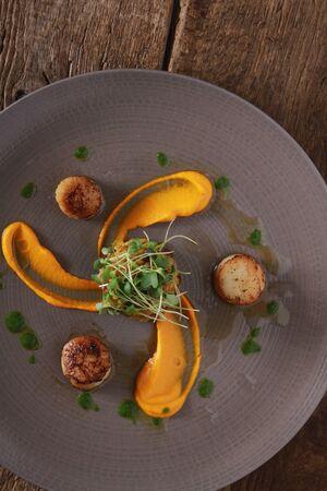mea: plated scallop appetizer mea