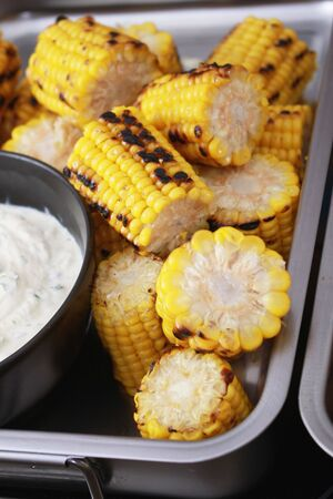 char: Fresh char grilled corn on the cob with yogurt dip