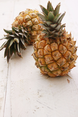 dwarves: dwarf mini pineapple on wooden background