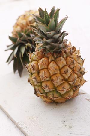 dwarf: dwarf mini pineapple on wooden background